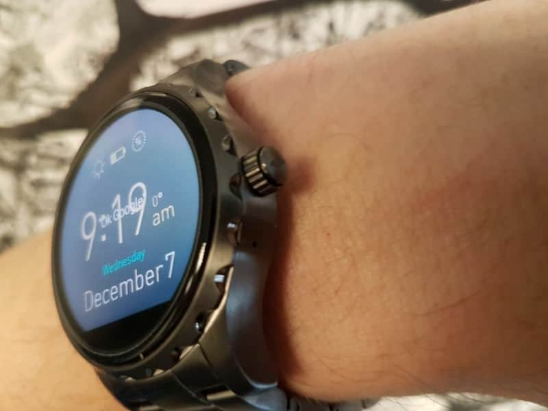 Side view of te Fossil Q Marshal Smartwatch and charger
