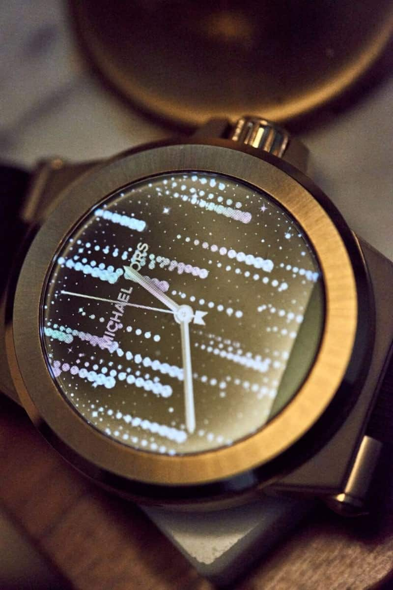 Gold Michael Kors smartwatch with future-oriented watch face design.