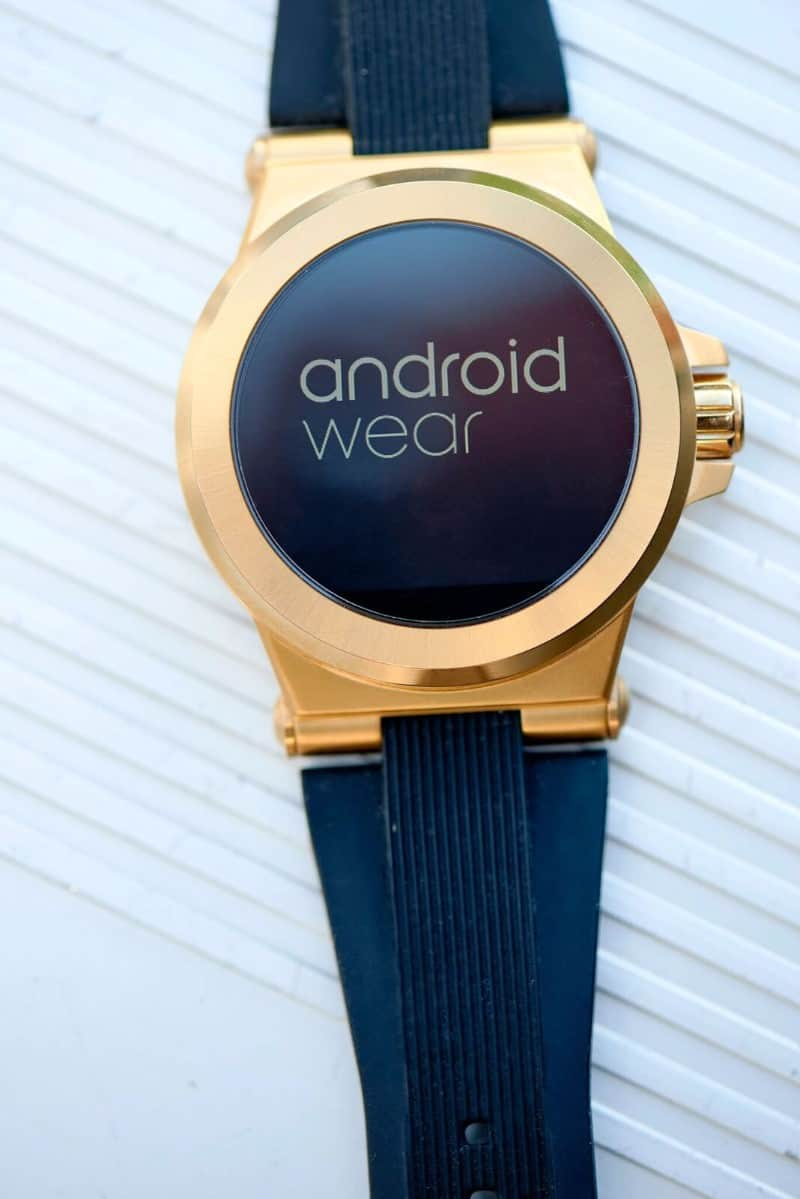 Gold Michael Kors Access smartwatch with all black band and watch face design.