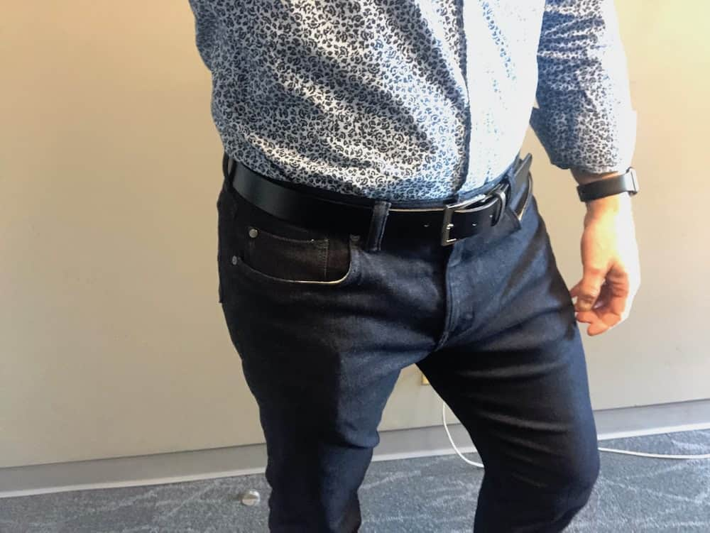 Front side view of dark blue Traveler jeans for men by Banana Republic