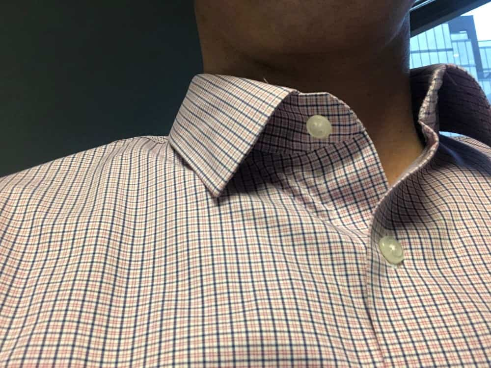 Banana Republic slim fit men's dress shirt collar and top button photo.