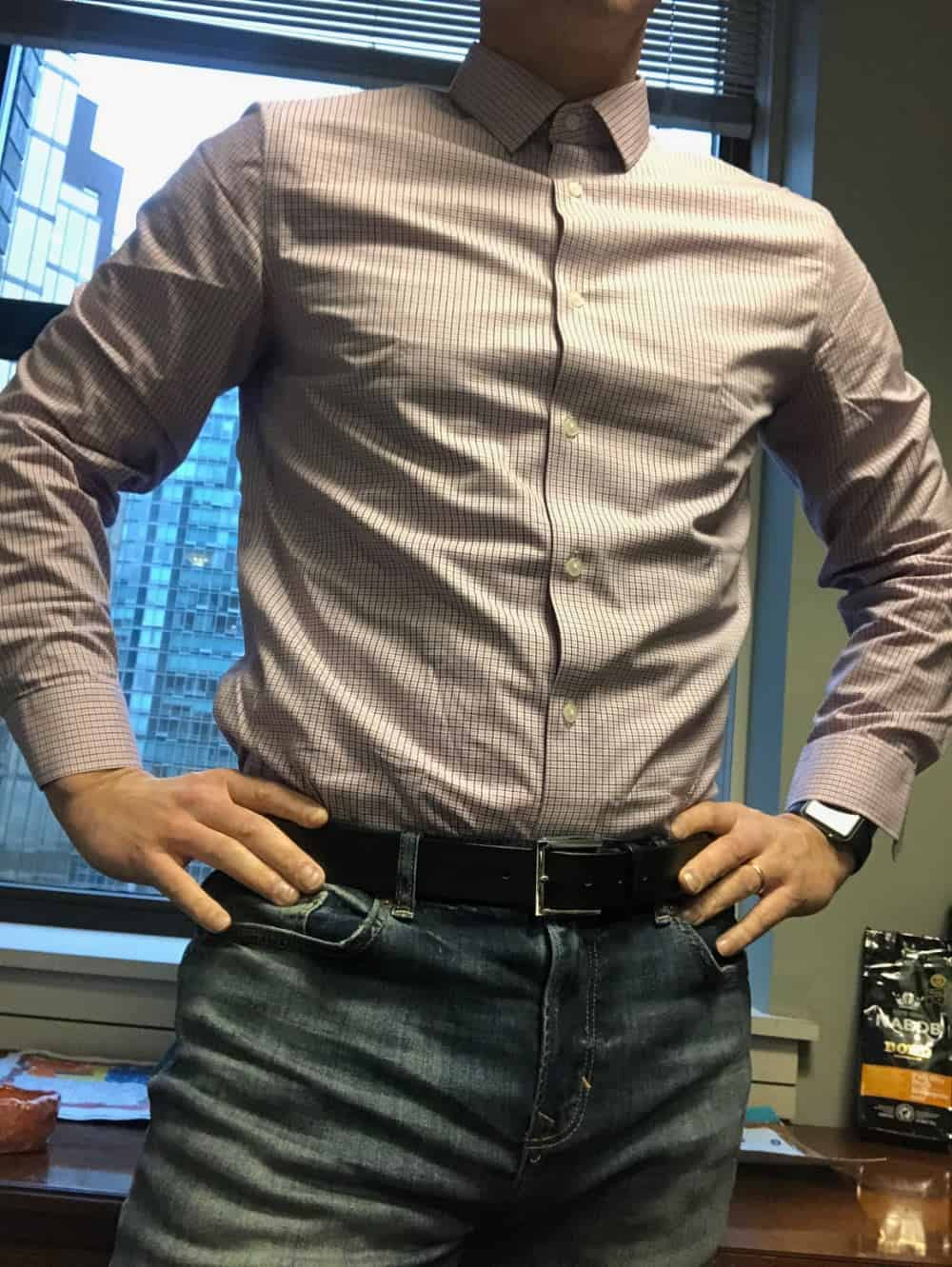 BR men's slim fit dress shirt tucked into jeans.
