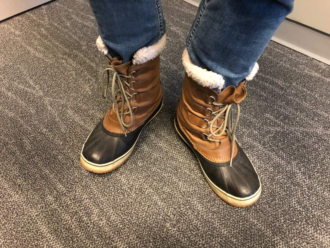 Photo with Sorel Caribou boots with jeans tucked in