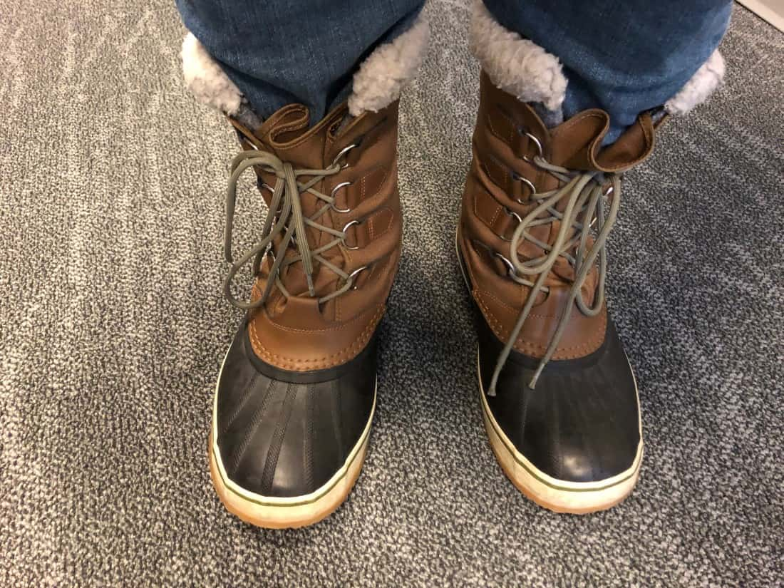Sorel Caribou boots laced up worn with jeans