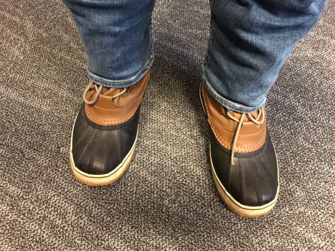 Photo of Sorel Caribou boots with jeans un-tucked