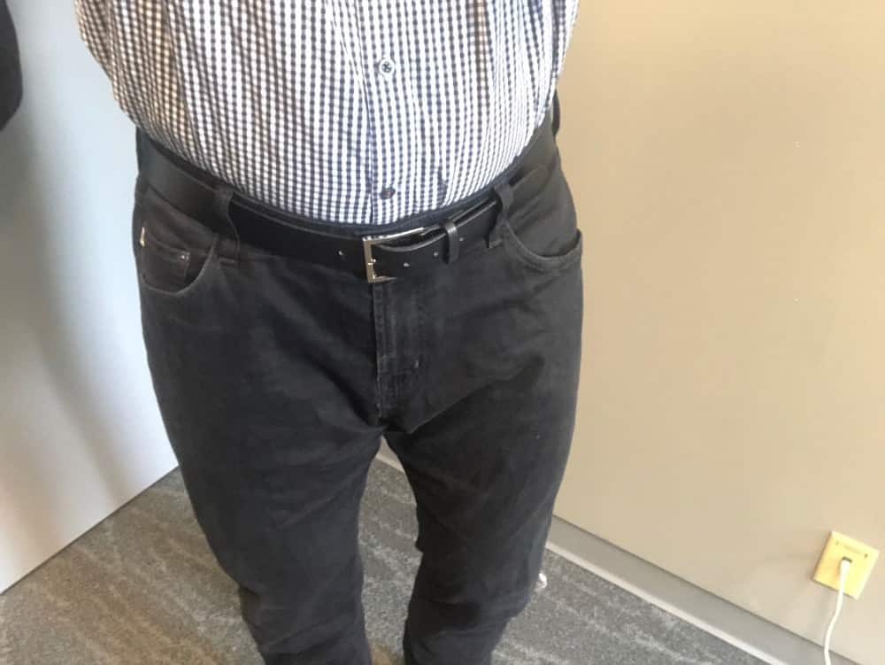 Black AG jeans for men with shirt tucked