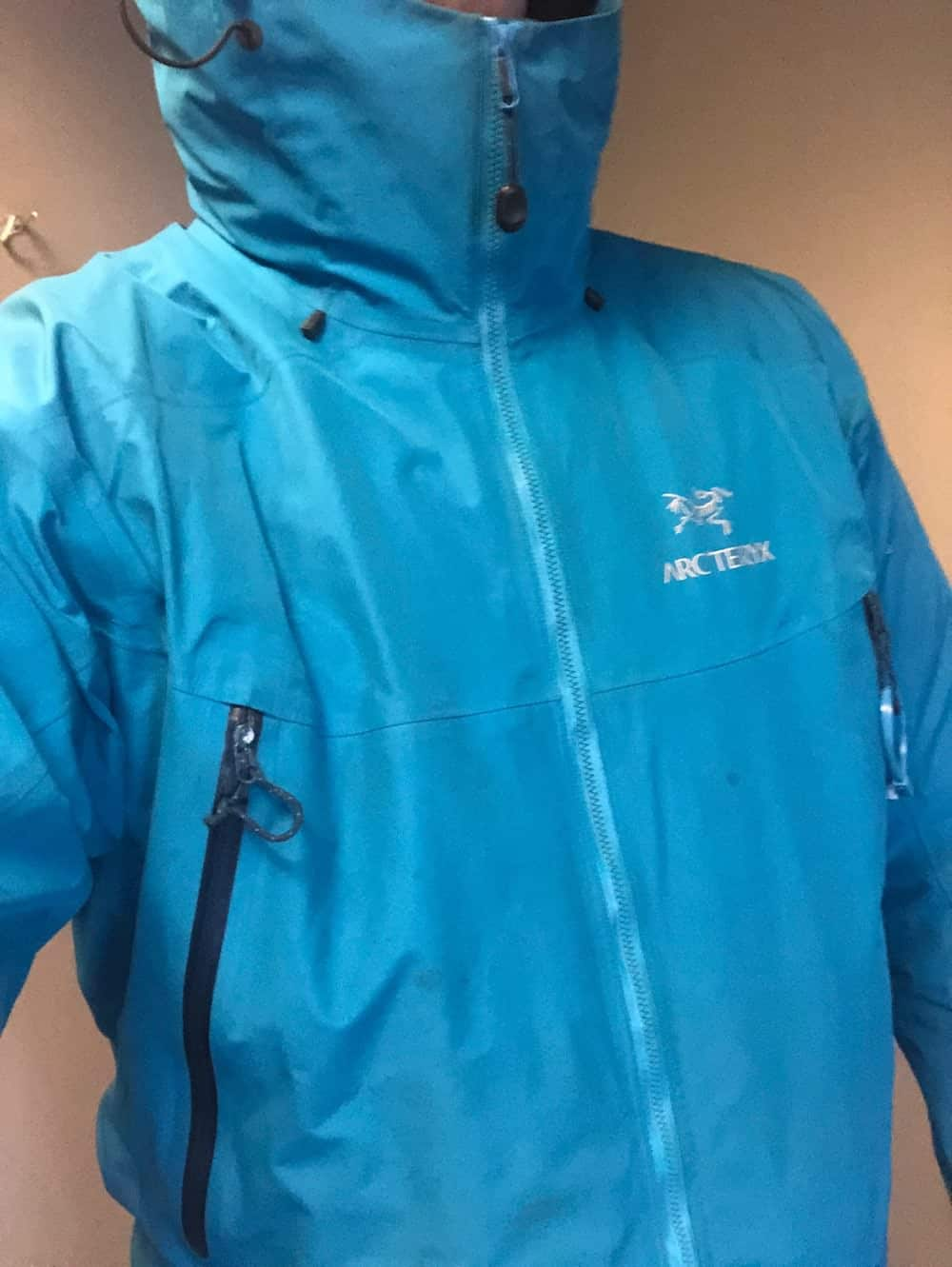 Arcteryx beta lt jacket on top of Canada Goose puffer jacket