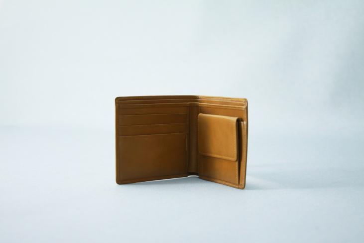 A brown bifold wallet