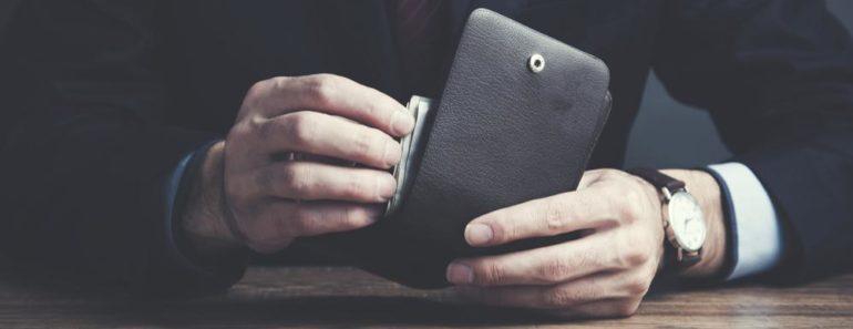 A man holding a wallet