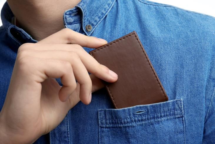A brown leather small pocket wallet