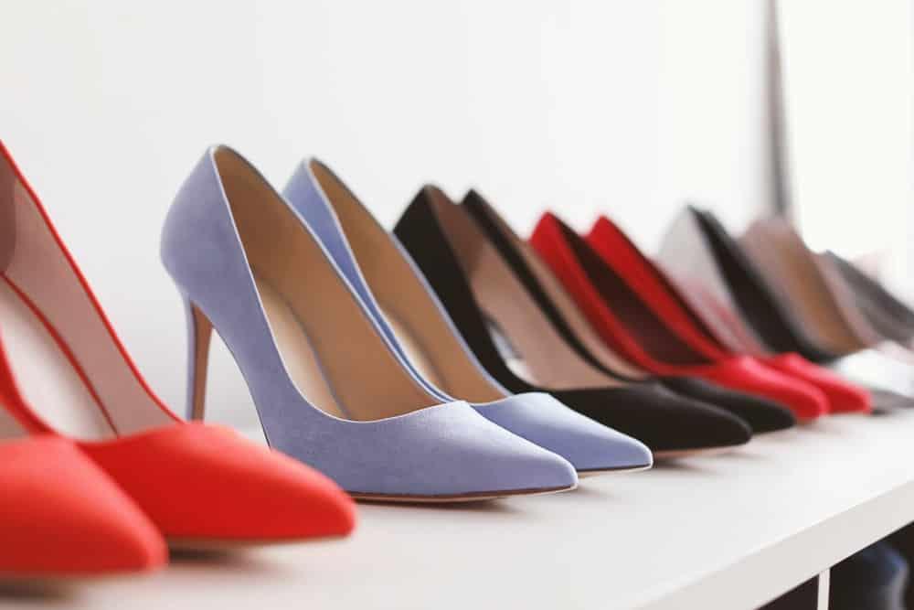 A display of high heels in various colors.