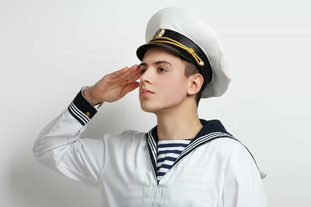 Young sailor giving a salute.