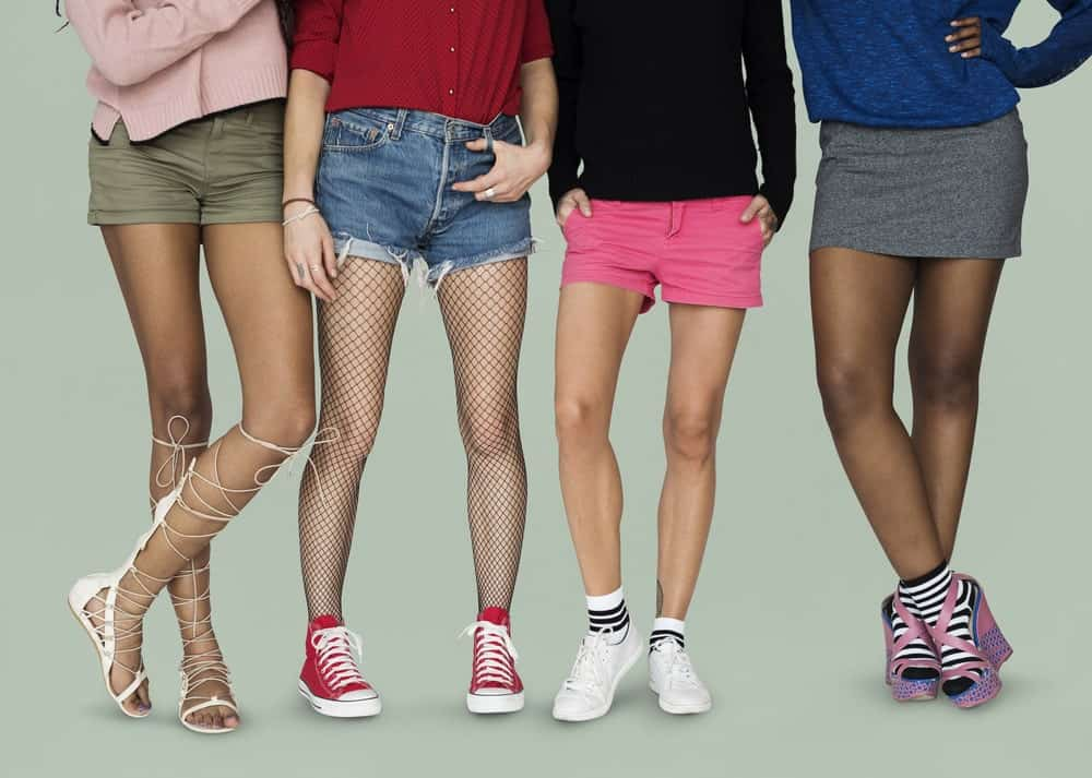 Shot of women's legs with different types of shorts and footwear.