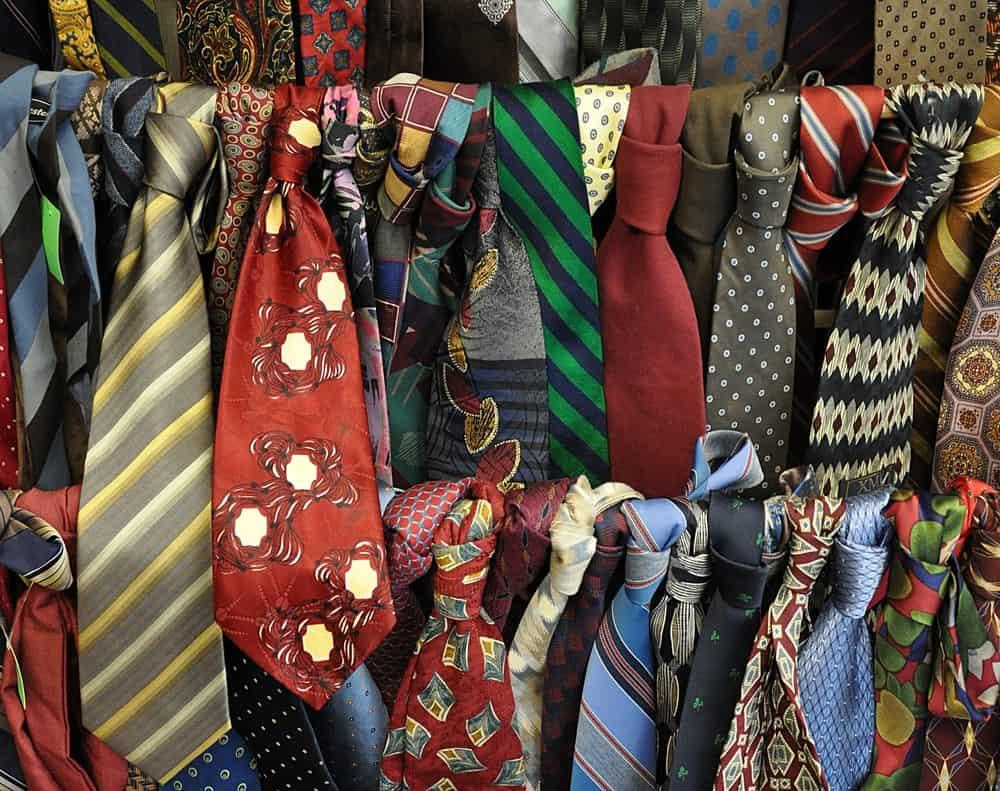 A display of various colorful vintage neckties.