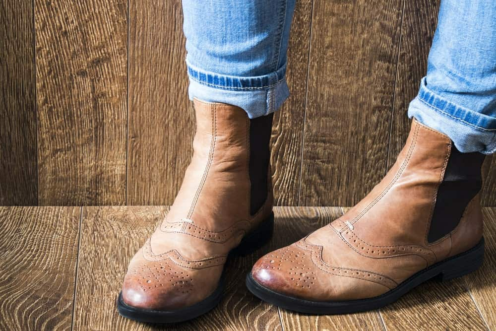 A close-up of brown Chelsea boots