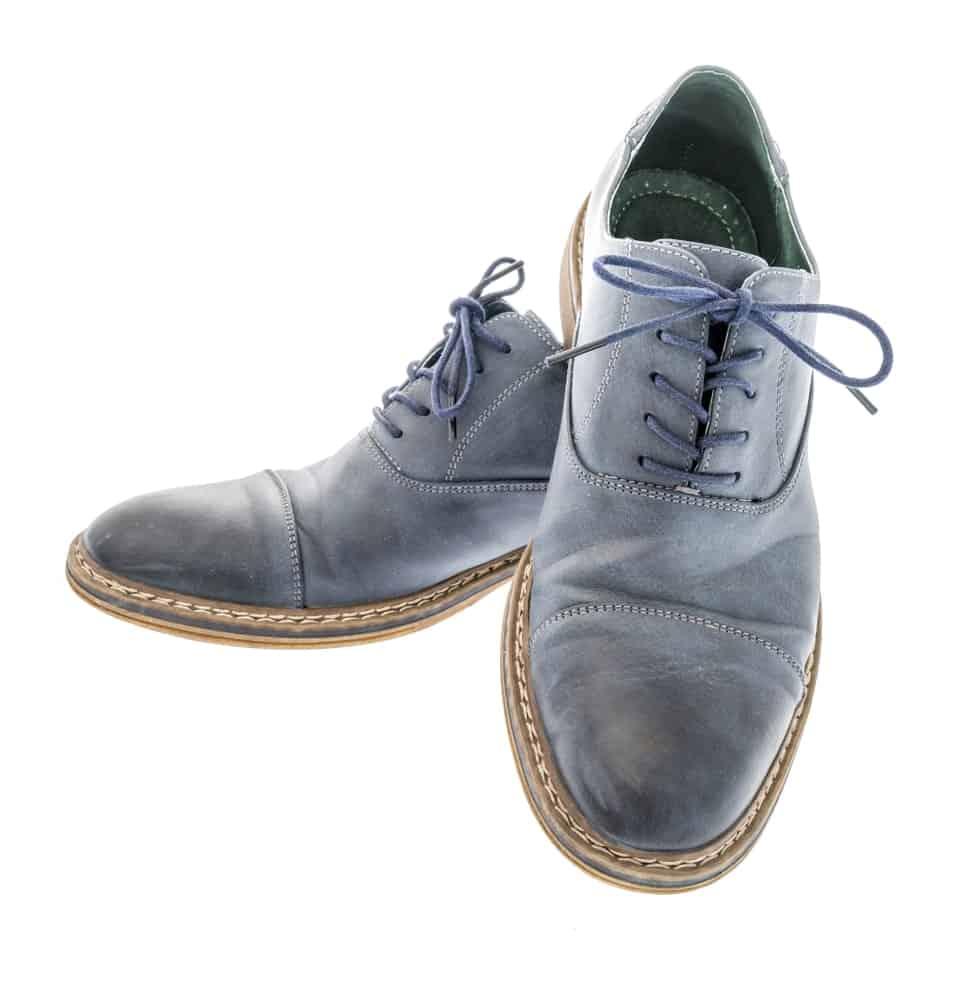 A pair of Oxford blue cap toe dress shoes