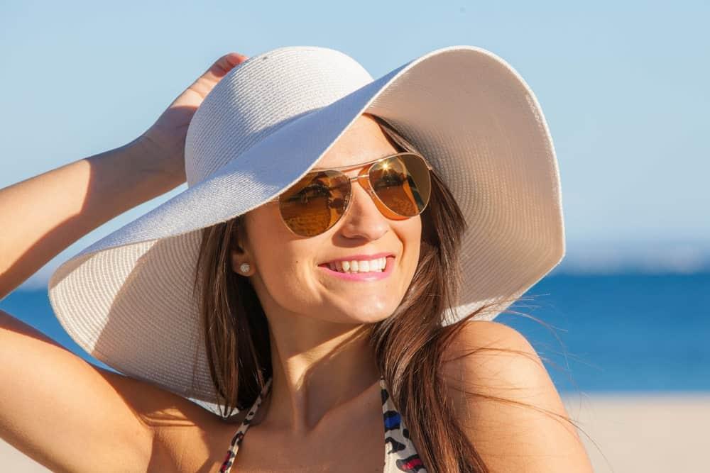 A Woman Wearing a Floppy Hat