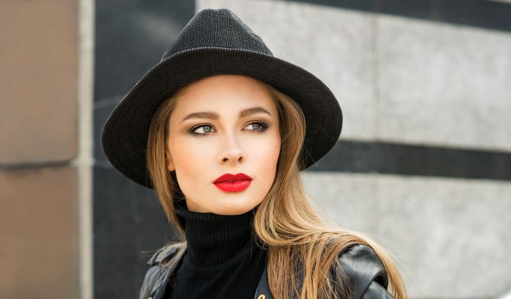 Young Woman with Red Lipstick and Black Hat