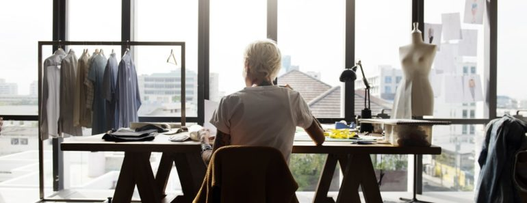 A woman sitting at her desk, planning on what to do