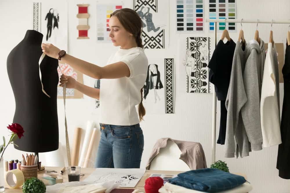 Designer taking measurements