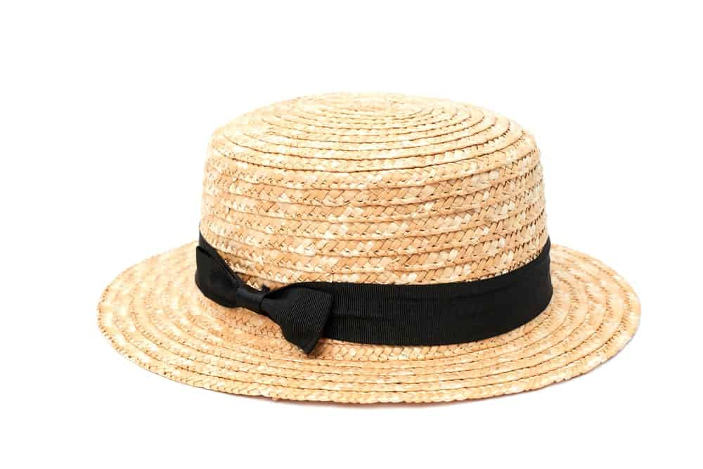 A Straw Boater Hat against White Background