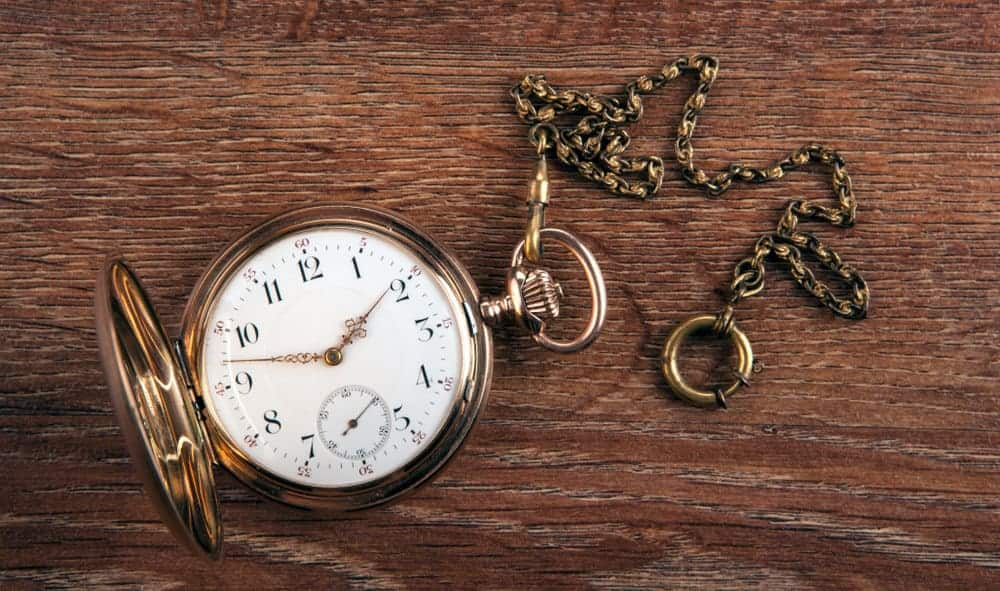 An antique pocket watch for men with chain.