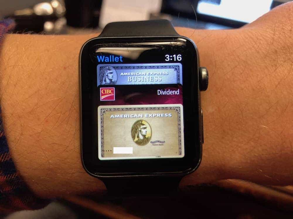 Apple Watch with screenshots of credit cards in Apple Pay.