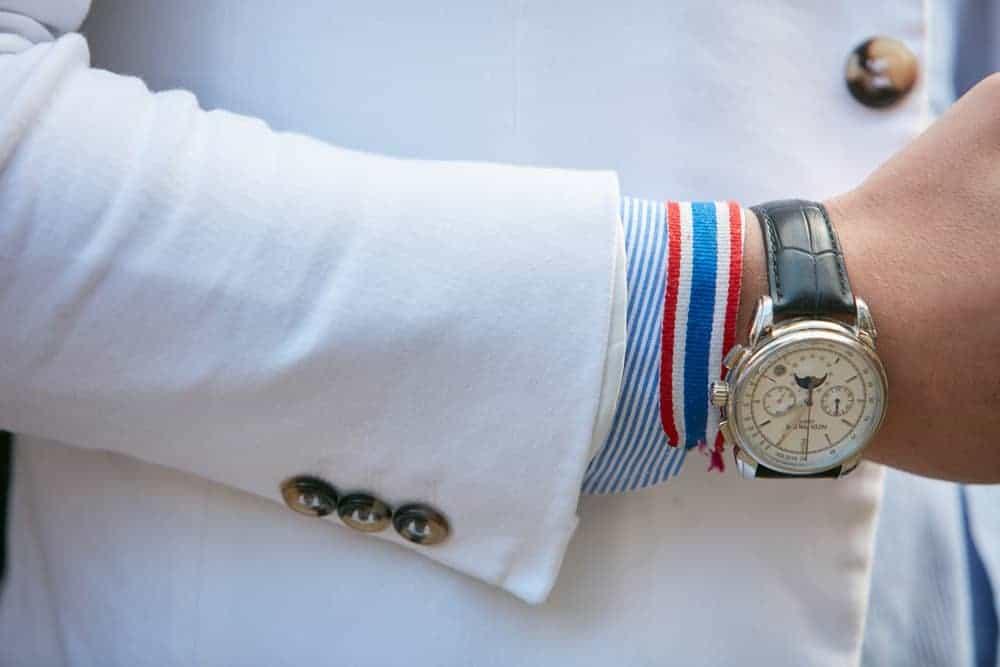 A Man wearing a Patek Philippe luxury watch.