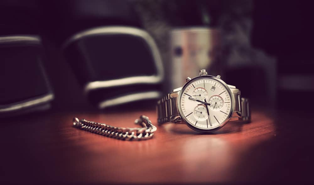 A silver analog wristwatch for men.