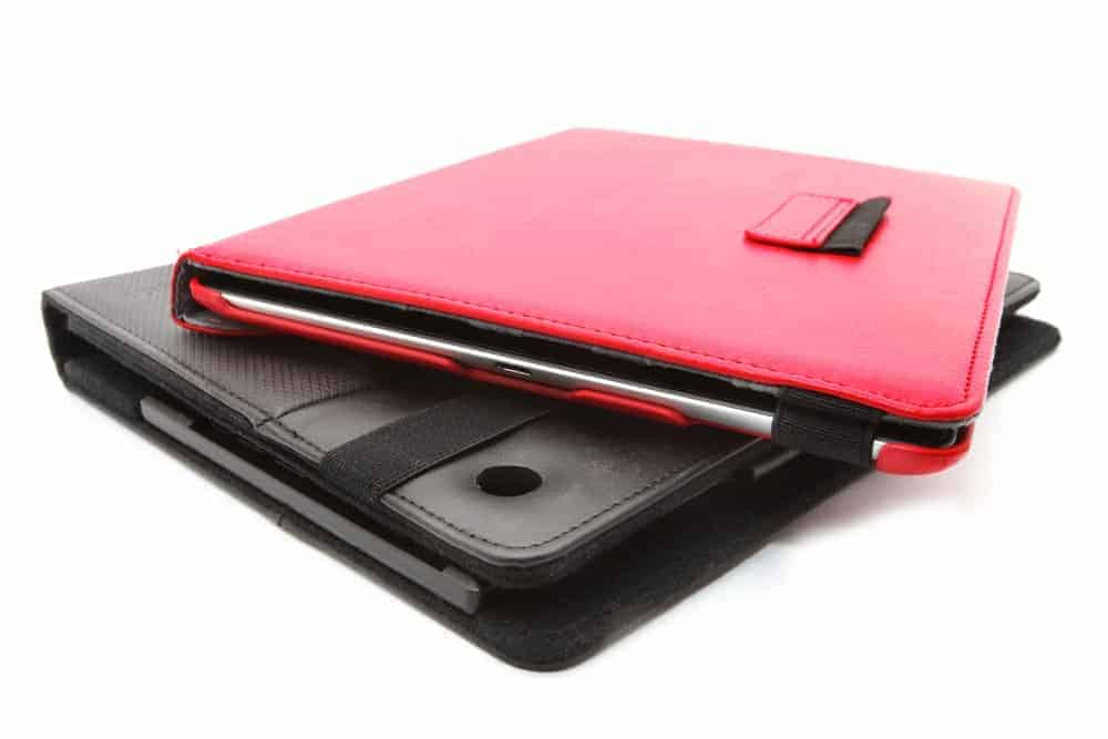 A red tablet case stacked on a black tablet case.