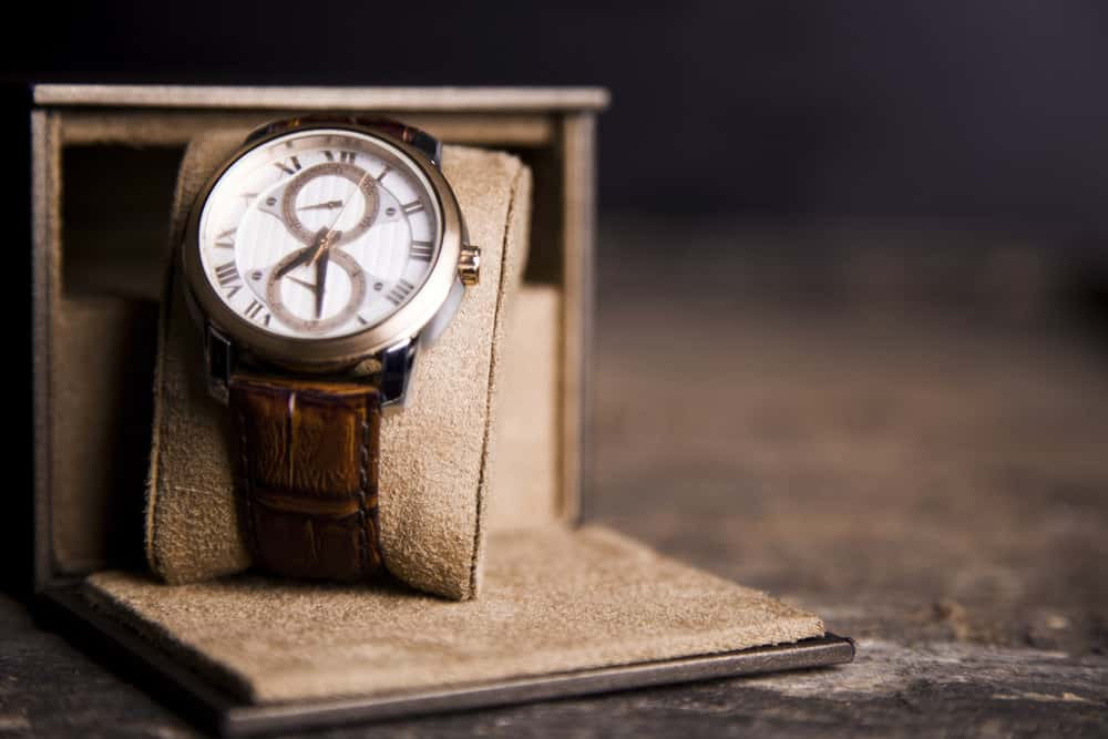 A vintage wristwatch for men with brown leather straps.