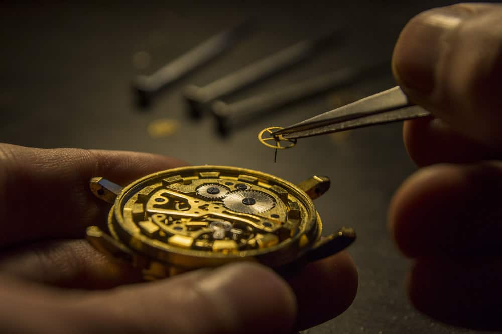 Watchmaker repairing an antique wristwatch.
