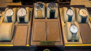 A variety of wristwatches on display at a store.