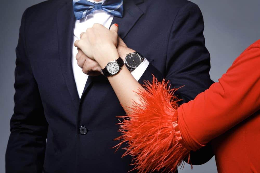 A stylish couple wearing wristwatches on their left hands.
