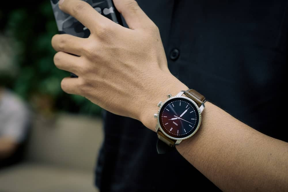 A man sporting a Fossil smartwatch.