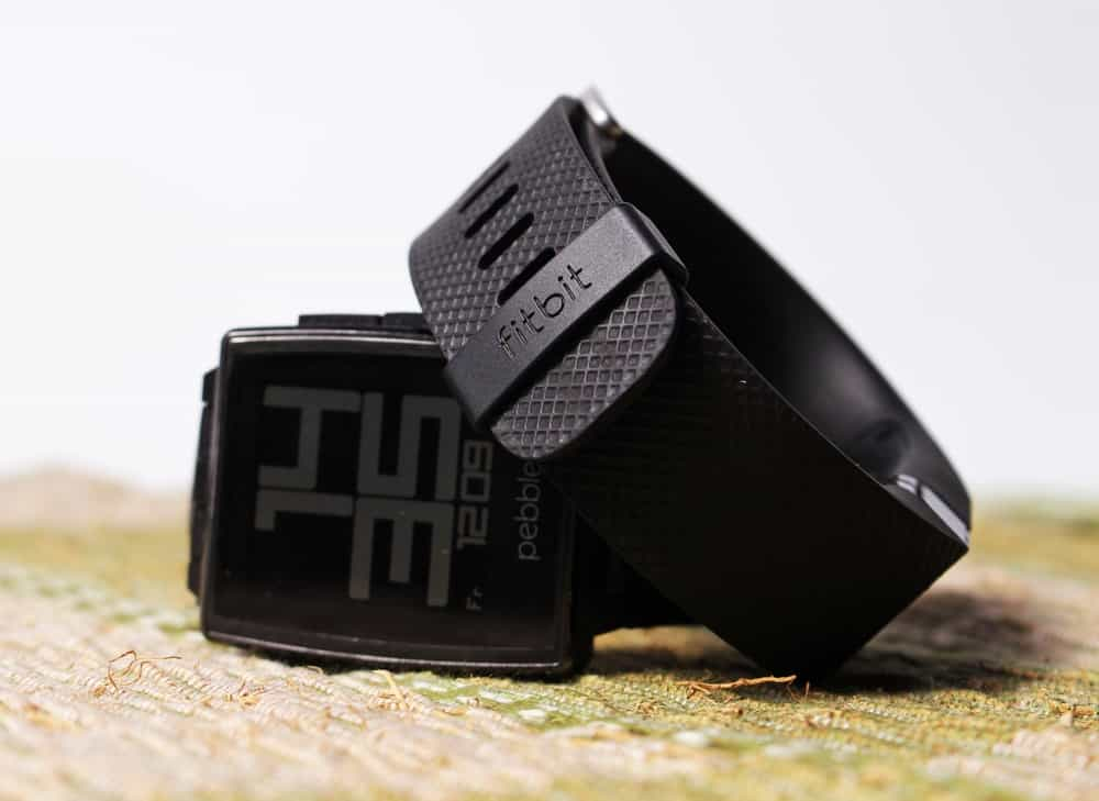 A close look at a couple of Fitbit Versa 2 with black sporty straps.