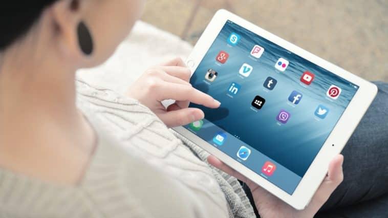 A close look at a woman using an iPad Air2 tablet.