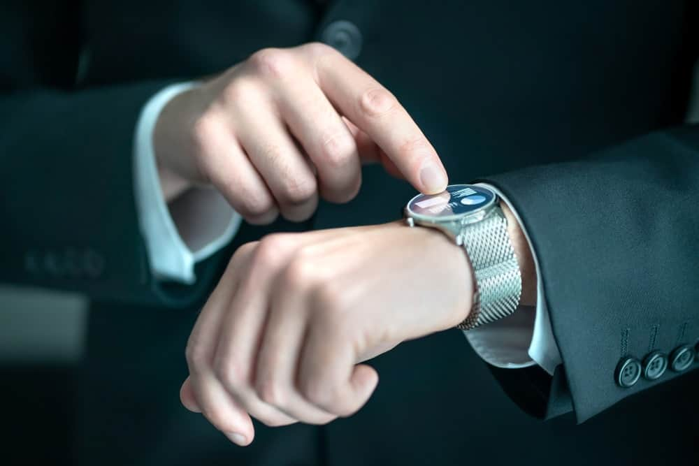 A businessman using the apps on his smartwatch.
